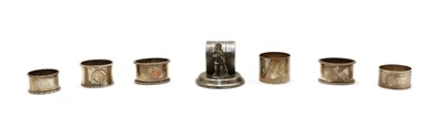 Lot 21 - Six silver napkin rings and a figural silver plated example