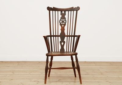 Lot 415 - A George III fruitwood and elm high comb back Windsor chair
