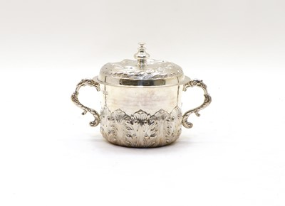 Lot 50 - A Charles II style Britannia silver porringer and cover