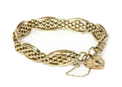 Lot 1111 - A 9ct gold gate bracelet