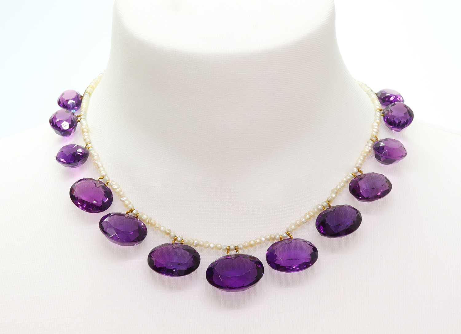 Lot 92 - A Victorian seed pearl and amethyst fringe necklace