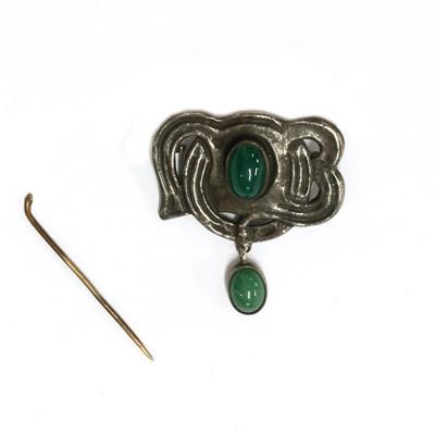 Lot 1052 - An Arts & Crafts silver brooch/pendant, by Murrle Bennett & Co.