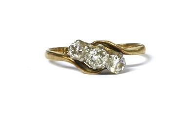 Lot 25 - A gold three stone diamond ring