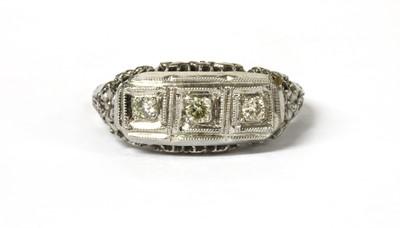 Lot 43 - An American white gold three stone diamond ring