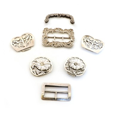 Lot 64 - A collection of four silver belt buckles