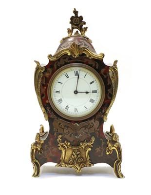Lot 86 - A French boule work mantel clock