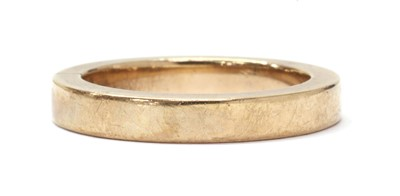 Lot 1075 - A gold flat section wedding ring