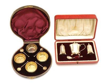 Lot 13 - A cased set of four silver table salts