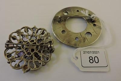 Lot 80 - A silver Arts & Crafts moonstone circle brooch