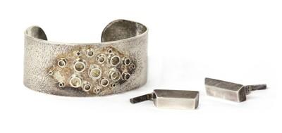Lot 1062 - A handmade sterling silver torque bangle