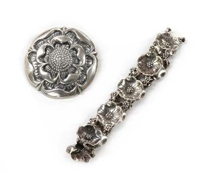 Lot 1054 - A sterling silver rose brooch, by Bernard Instone