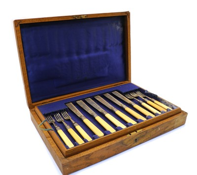 Lot 3 - An oak cased set of eight fish knives and forks