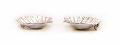 Lot 47 - A George III silver butter shells