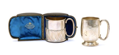 Lot 28 - A cased Victorian silver christening mug