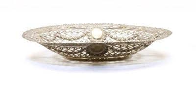 Lot 4 - A German silver basket, with pierced, pressed and repousse decoration