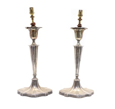 Lot 12 - A pair of early 20th century silver candlesticks