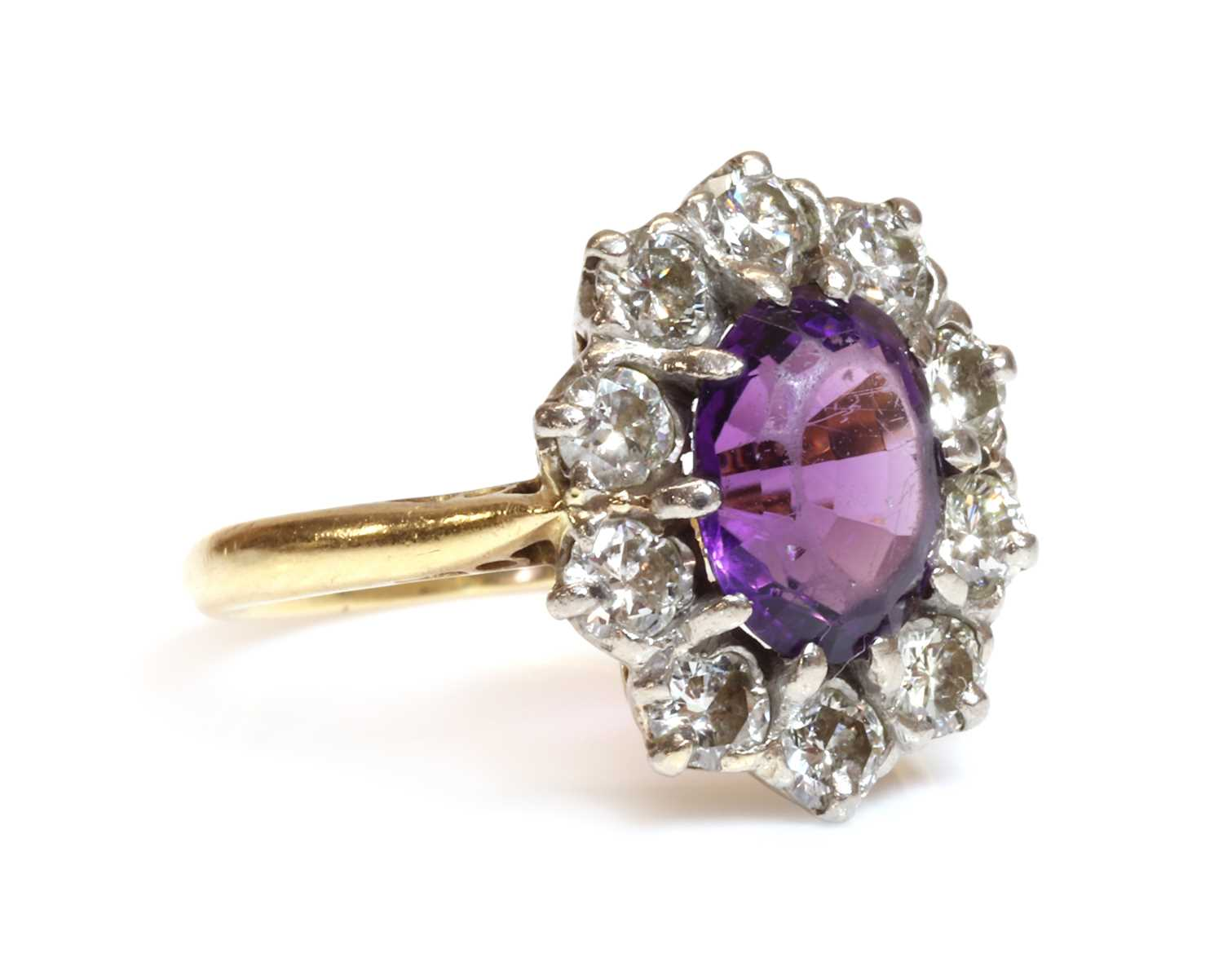 Lot 69 - An 18ct gold amethyst and diamond cluster ring, by Arthur & Co., c.1970