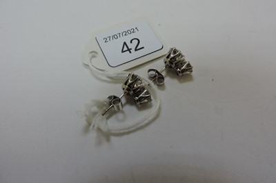 Lot 42 - A pair of two stone diamond stud earrings
