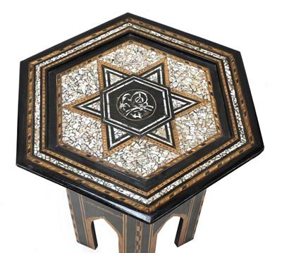Lot 35 - An ebonised Damascene coffee table