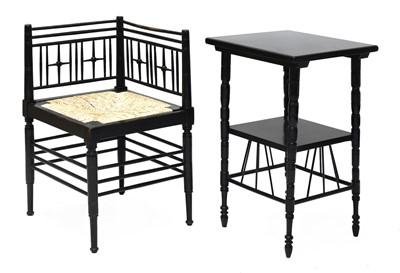 Lot 44 - An ebonised Liberty & Co. 'Argyll' corner chair