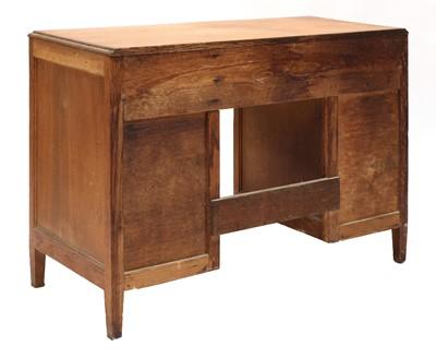 Lot 90 - A Cotswold School oak kneehole desk