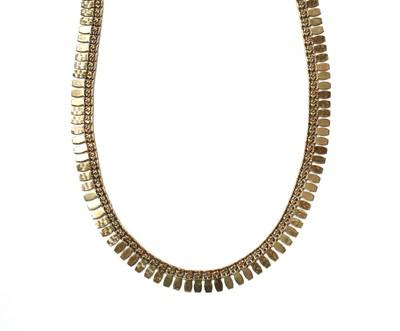 Lot 1058 - A gold fringe necklace