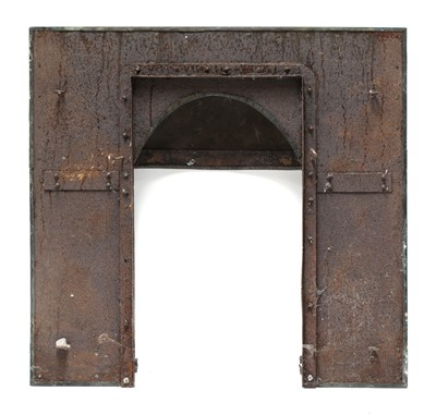 Lot 41 - An Arts and Crafts verdigris patinated fireplace insert