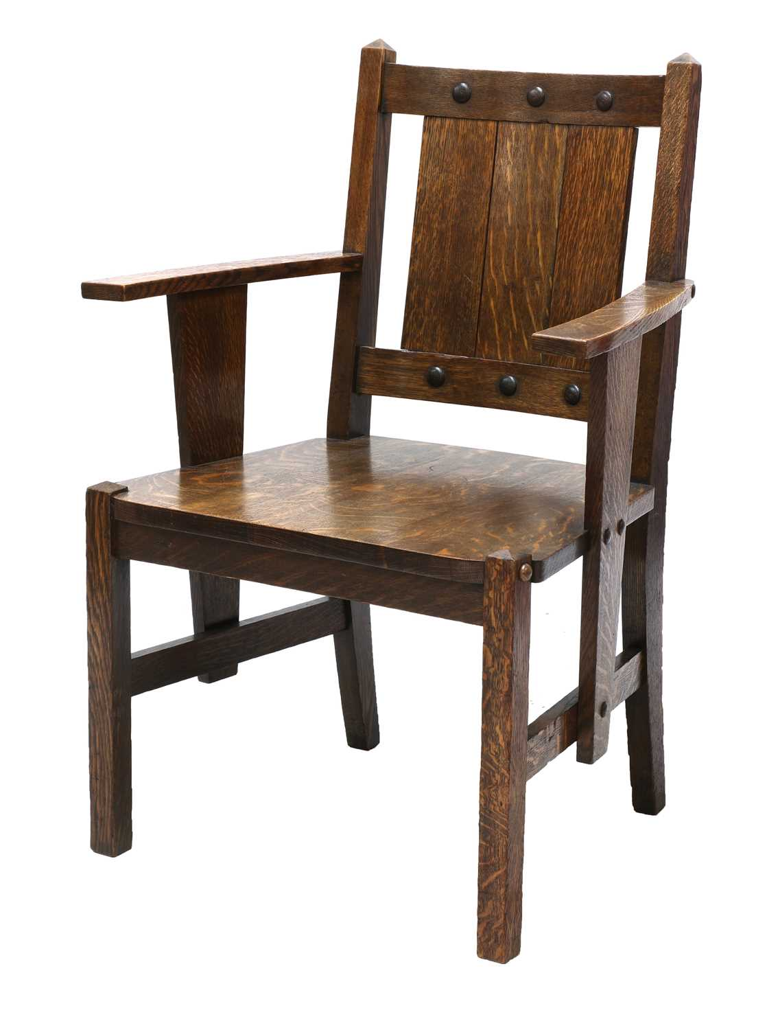 Lot 87 - An Arts and Crafts oak elbow chair