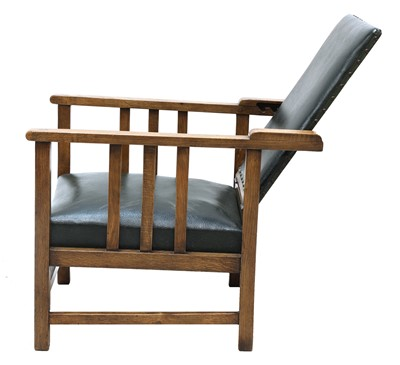 Lot 86 - An Arts and Crafts oak reclining armchair