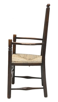 Lot 66 - An Arts and Crafts oak armchair