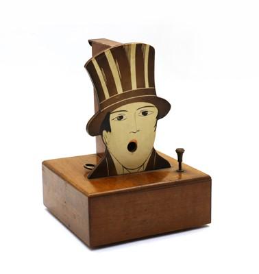 Lot 104 - A French musical box cigarette dispenser