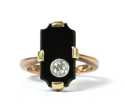 Lot 1045 - A gold diamond and onyx ring