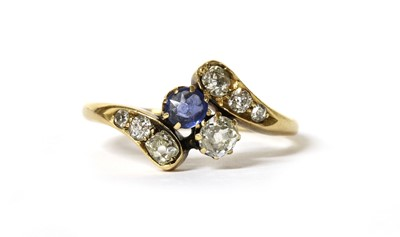 Lot 1026 - An Edwardian gold sapphire and diamond crossover ring