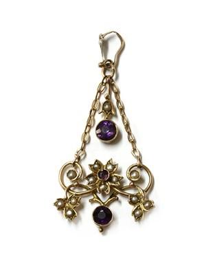 Lot 1039 - An Edwardian gold amethyst and split pearl pendant