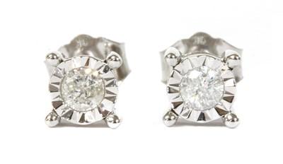 Lot 41 - A pair of white gold single stone diamond stud earrings