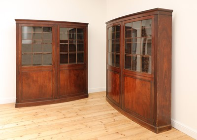 Lot 19 - A pair of mahogany bow front bookcases