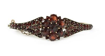 Lot 2 - A late 19th century Bohemian garnet bangle