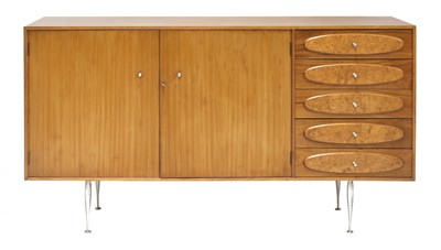 Lot 589 - A teak and burrwood sideboard