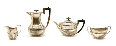 Lot 1 - A composed four-piece silver tea service