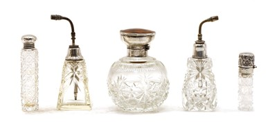 Lot 16 - Five cut glass silver collared perfume bottles
