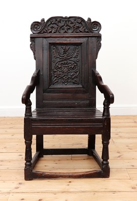 Lot 406 - An oak wainscot armchair