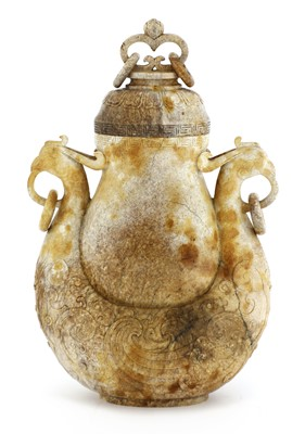 Lot 94 - A Chinese jade vase and cover