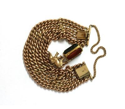 Lot 62 - A gold four row curb bracelet
