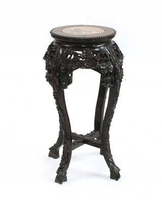 Lot 84 - A Chinese hardwood jardiniere stand