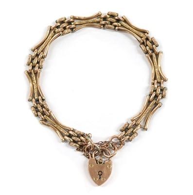Lot 1112 - A 9ct gold gate bracelet