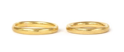 Lot 1073 - Two 22ct gold court section wedding rings