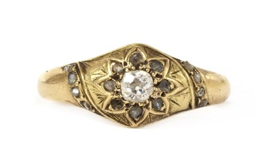 Lot 1033 - A Victorian gold diamond star cluster ring