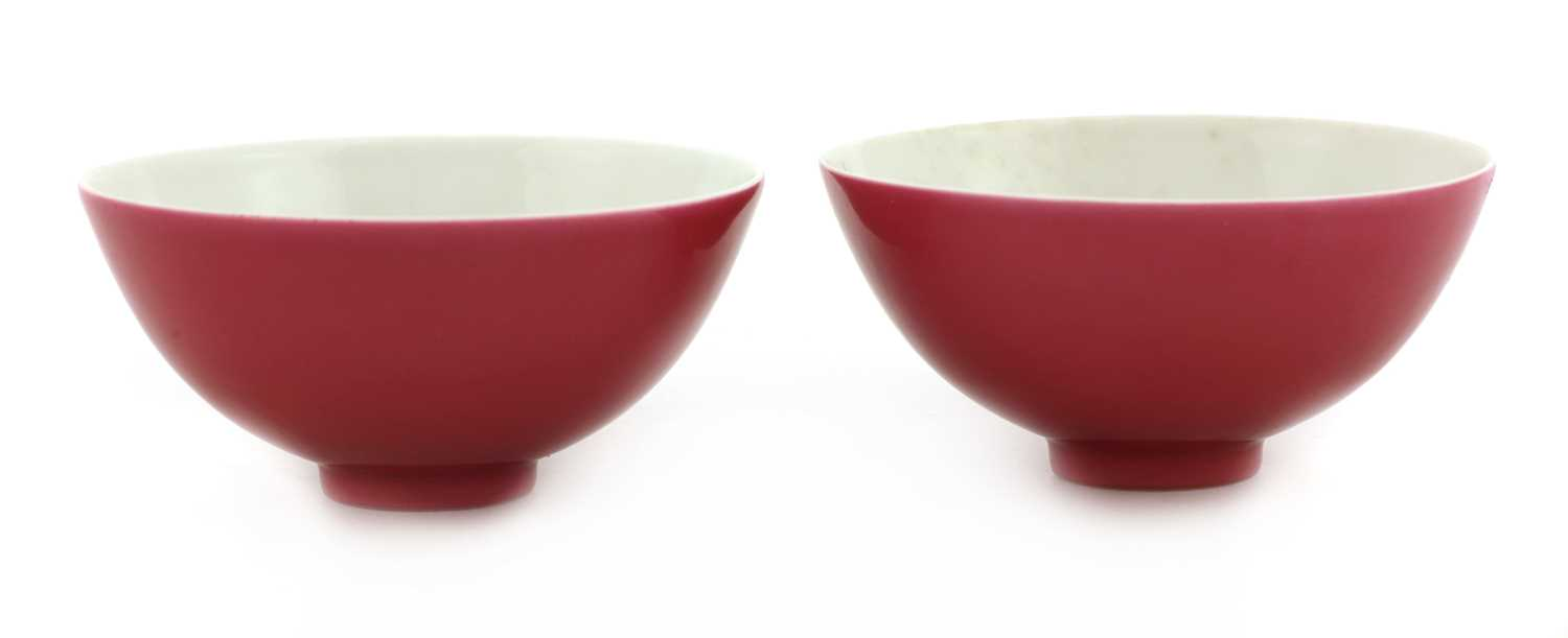 Lot 64 - A pair of Chinese ruby-enamelled tea bowls