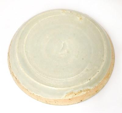 Lot 14 - A Chinese qingbai saucer