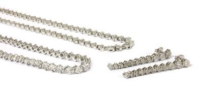 Lot 51 - A silver diamond set necklace, bracelet and earrings suite